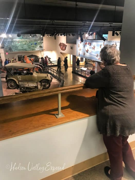 Woman looking at canon room at the West Point Museum