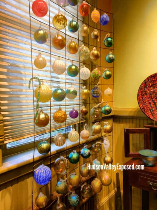 Ornaments hanging by back wall at Hudson Beach Glass