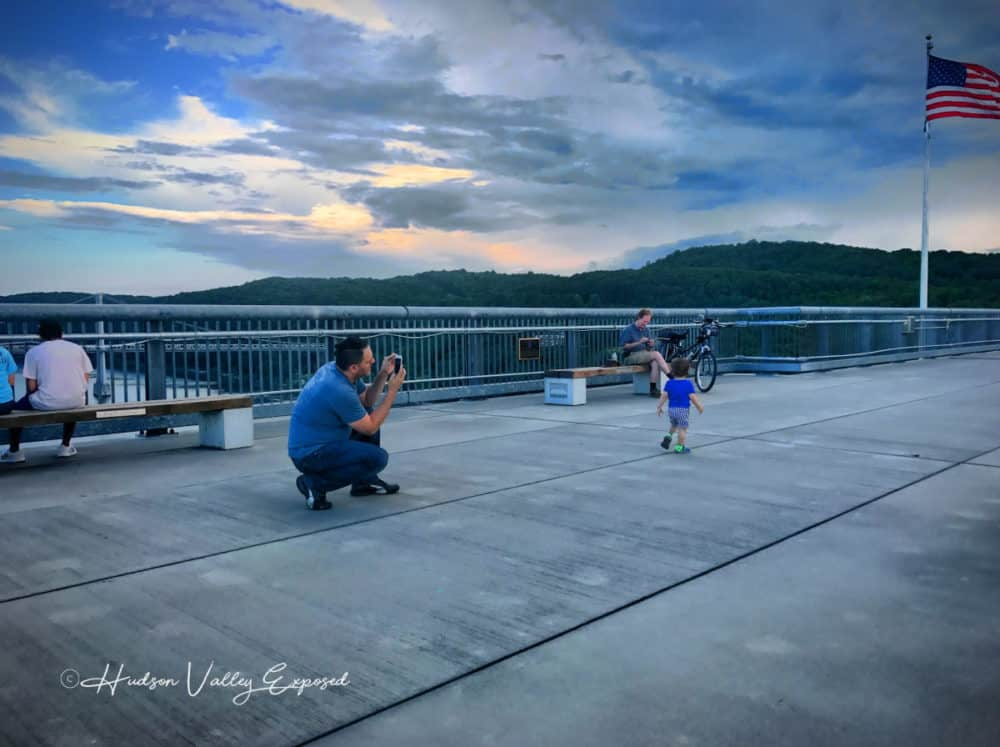 Father taking picture of son on the Walkway on the Hudson