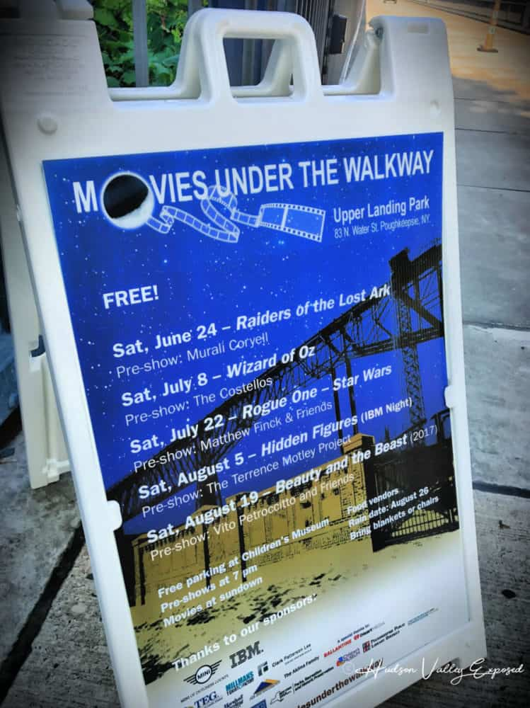 Sign advertising the Movies Under the Walkway Summer Events