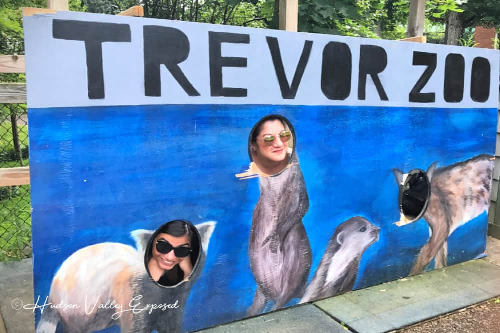 Jackie and her daughter at the painted Trevor Zoo sign in Millbrook