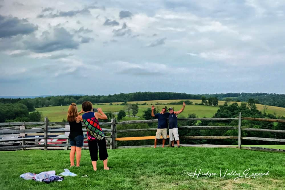 People enjoying the site of the 1969 Woodstock Festival