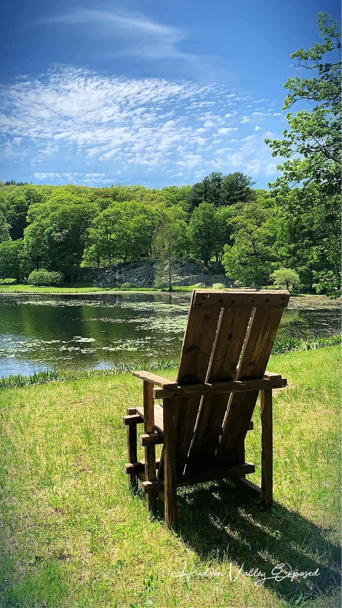 A chair by the lake at this great Millbrook Garden. Innisfree Garden is a great place to visit.