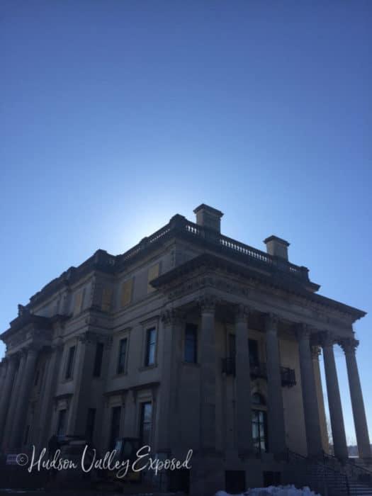 Vanderbilt Mansion with the sun setting behind it